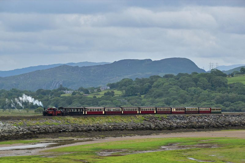 Steam train crossing the Porthmadog Cob.